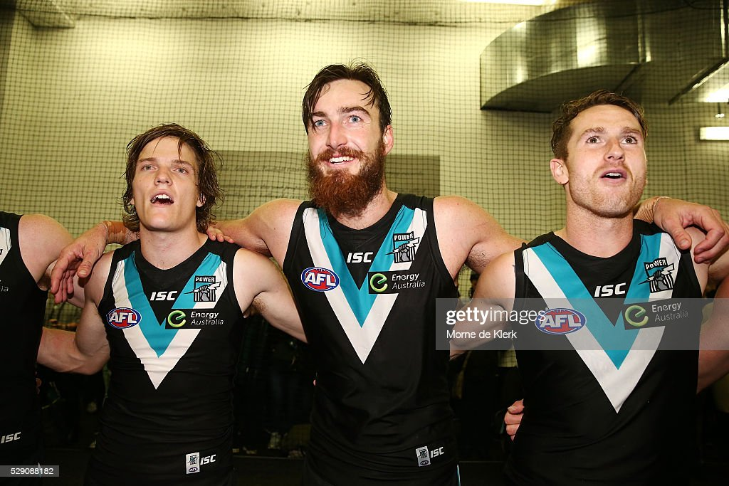 Jared Polec, Charlie Dixon and Cam O'Shea of the Power celebrates in the rooms after the round seven AFL match between the Port Adelaide Power and the Brisbane Lions at Adelaide Oval on May 8, 2016 in Adelaide, Australia.