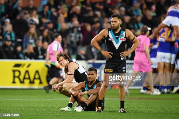 Jared Polec Jake Neade of the Power and Karl Amon of the Power look on dejected after the AFL First Elimination Final match between Port Adelaide...