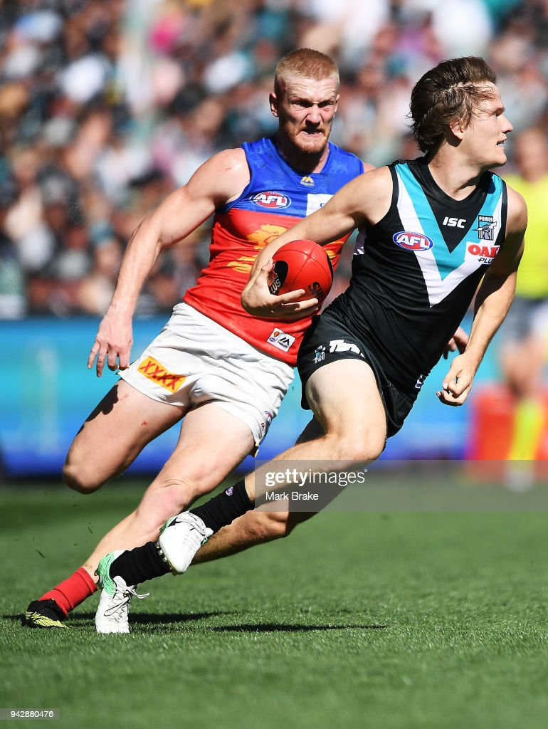 Jared Polec of Port Adelaide gets away from a bleeding Nick Robertson of the Lions during the round three AFL match between the Port Adelaide Power and the Brisbane Lions at Adelaide Oval on April 7, 2018 in Adelaide, Australia.