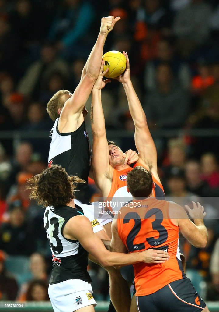 Jared Polec of the Power and Jonathan Patton of the Giants contest a mark during the round four AFL match between the Greater Western Sydney Giants and the Port Adelaide Power at UNSW Canberra Oval on April 15, 2017 in Canberra, Australia.