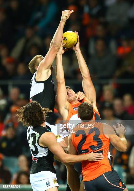 Jared Polec of the Power and Jonathan Patton of the Giants contest a mark during the round four AFL match between the Greater Western Sydney Giants...