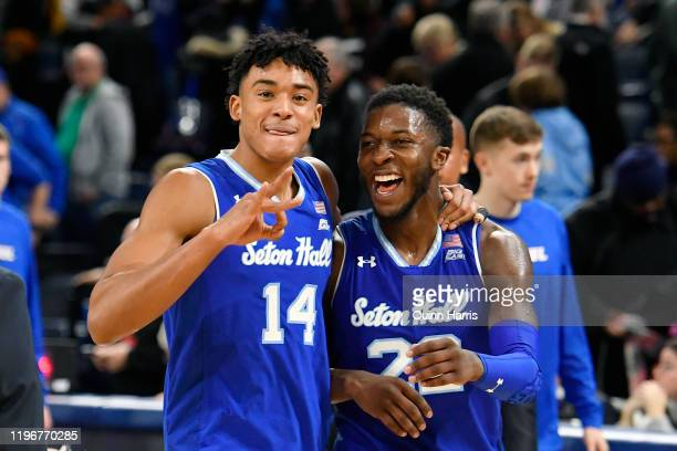 Jared Rhoden and Myles Cale of the Seton Hall Pirates celebrate the win against the DePaul Blue Demons at Wintrust Arena on December 30, 2019 in...