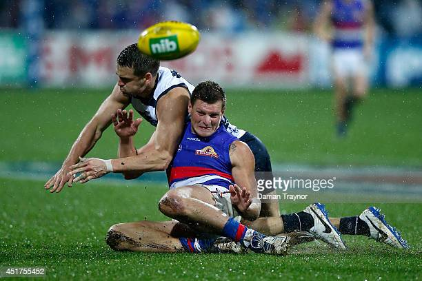 Jared Rivers of the Cats and Jack Redpath of the Bulldogs compete during the round 16 AFL match between the Geelong Cats and the Western Bulldogs at...