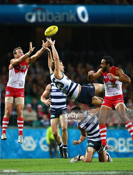 Jared Rivers of the Cats flies for a mark against Jude Bolton of the Swans during the round four AFL match between the Sydney Swans and the Geelong...