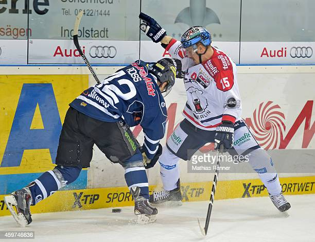 Jared Ross of ERC Ingolstadt and T.J. Mulock of the Eisbaeren Berlin fight for the puck during the game between ERC Ingolstadt and Eisbaeren Berlin...