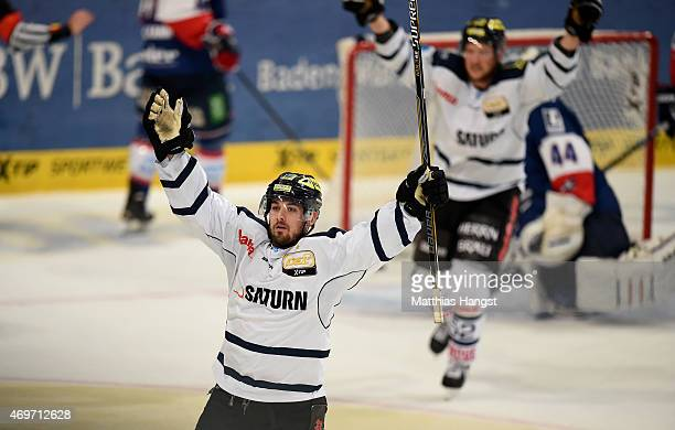 Jared Ross of Ingolstadt celebrates with his team-mates after scoring his team's fourth goal during the DEL Play-offs Final Game 3 between Adler...