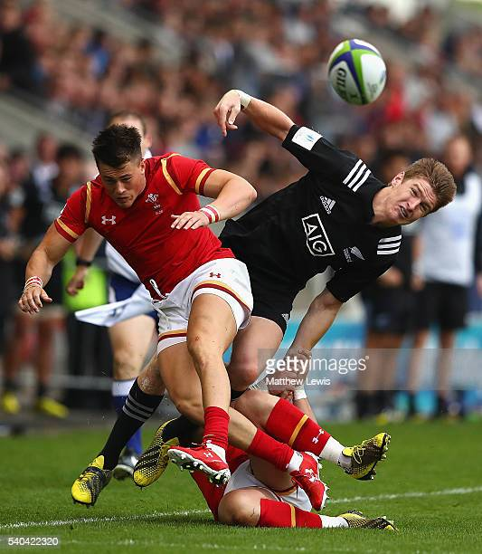 Jared Rosser of Wales and Jordie Barrett of New Zealand collide during the World Rugby U20 Championship match between New Zealand and Wales at AJ...