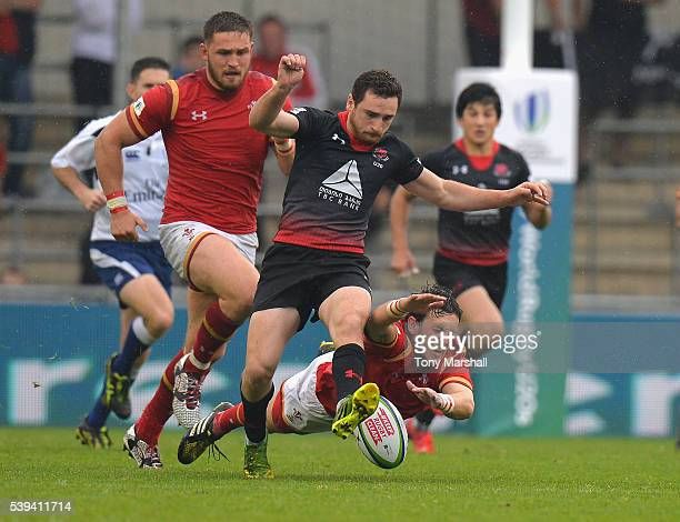Jared Rosser of Wales tackles Vasil Lobzhanidze of Georgia during the World Rugby U20 Championship match between Wales and Georgia at The Academy...