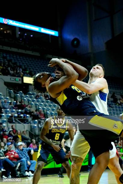 Jared Sam of the Fort Wayne Mad Ants battles for the ball against Mitch Creek of the Long Island Nets on December 7 2018 at Allen County War Memorial...