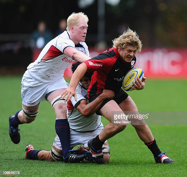 Jared Saunders of Saracens is tackled by Scott Lavalla and Mike Petri of USA during the friendly match between Saracens and USA at the Honourable...