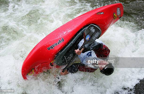 Jared Seiler of Pennsylvania competes in the Men's Kayak Pro Freestyle Qualifier in Whitewater Park on Gore Creek during The Teva Mountain Games on...