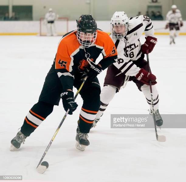 Jared Shaw of Gardiner looks to evade Jake MacDonald of Greely during a boys hockey at Family Ice in Falmouth on Monday January 21 2019 Greely won 72