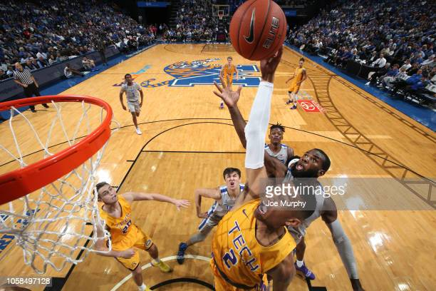 Jared Sherfield of the Tennessee Tech Golden Eagles looks to dunk against Raynere Thornton of the Memphis Tigers on November 6, 2018 at FedExForum in...