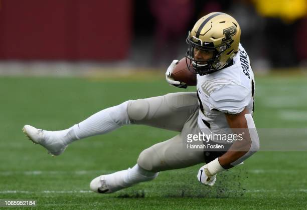 Jared Sparks of the Purdue Boilermakers falls to the field during the first quarter of the game against the Minnesota Golden Gophers at TCFBank...