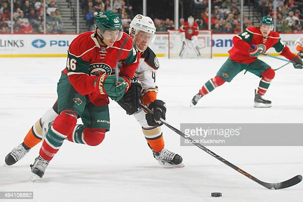 Jared Spurgeon of the Minnesota Wild and Jiri Sekac of the Anaheim Ducks skate to a loose puck during the game on October 24 2015 at the Xcel Energy...
