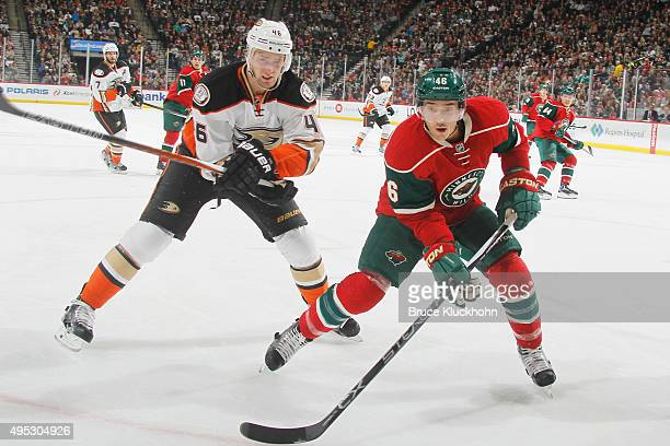 Jared Spurgeon of the Minnesota Wild and Jiri Sekac of the Anaheim Ducks skate to the puck during the game on October 24 2015 at the Xcel Energy...