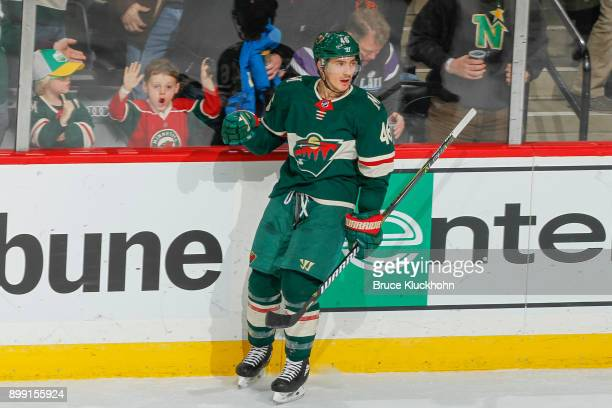 Jared Spurgeon of the Minnesota Wild celebrates after scoring a goal against the Dallas Stars during the game at the Xcel Energy Center on December...