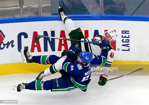 Jared Spurgeon of the Minnesota Wild collides with Tyler Motte of the Vancouver Canucks in Game One of the Western Conference Qualification Round...