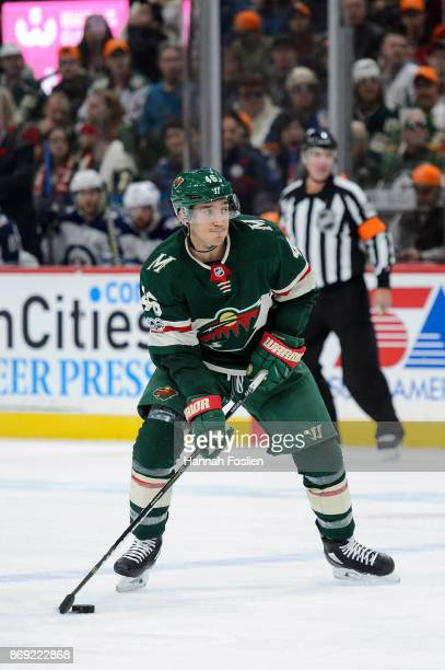 Jared Spurgeon of the Minnesota Wild controls the puck against the Winnipeg Jets during the game on October 31 2017 at Xcel Energy Center in St Paul...
