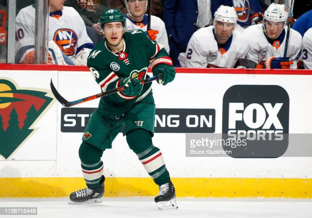 Jared Spurgeon of the Minnesota Wild makes a pass during a game against the New York Islanders at Xcel Energy Center on March 17 2019 in St Paul...