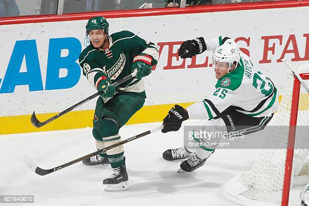 Jared Spurgeon of the Minnesota Wild passes the puck with Brett Ritchie of the Dallas Stars defending during the game on October 29 2016 at the Xcel...