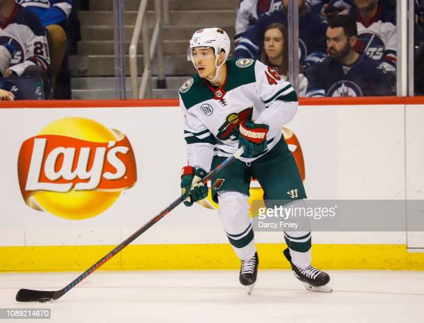 Jared Spurgeon of the Minnesota Wild plays the puck up the ice during third period action against the Winnipeg Jets at the Bell MTS Place on December...