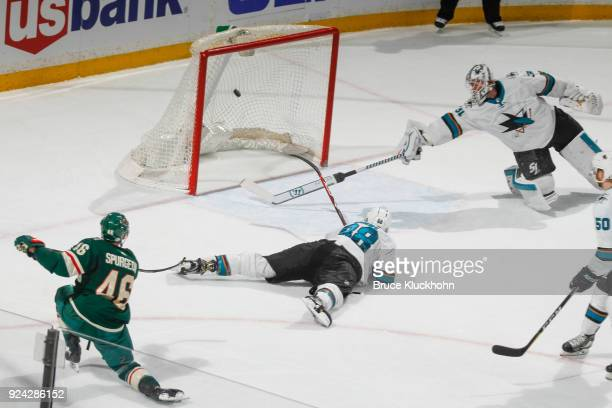 Jared Spurgeon of the Minnesota Wild scores the game winning goal in overtime against Brent Burns and goalie Martin Jones of the San Jose Sharks at...
