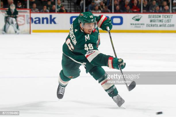 Jared Spurgeon of the Minnesota Wild shoots the puck against the Chicago Blackhawks during the game at the Xcel Energy Center on November 4 2017 in...
