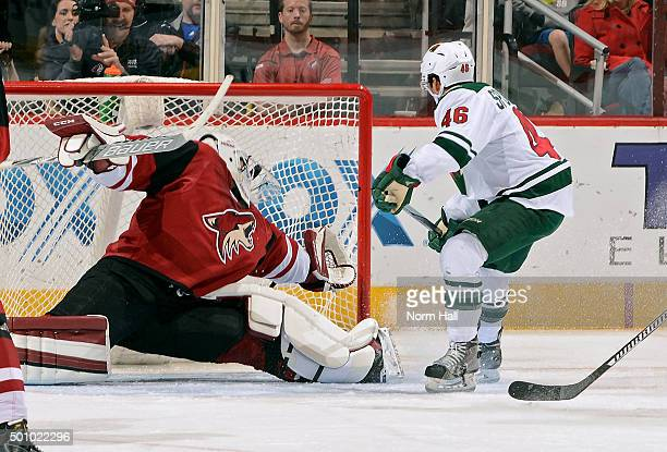 Jared Spurgeon of the Minnesota Wild shoots the puck past goaltender Anders Lindback of the Arizona Coyotes for a second period goal at Gila River...