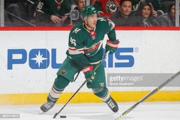 Jared Spurgeon of the Minnesota Wild skates with the puck against the Nashville Predators during the game at the Xcel Energy Center on December 29...