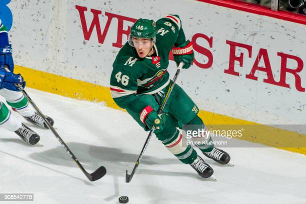 Jared Spurgeon of the Minnesota Wild skates with the puck against the Vancouver Canucks during the game at the Xcel Energy Center on January 14 2018...