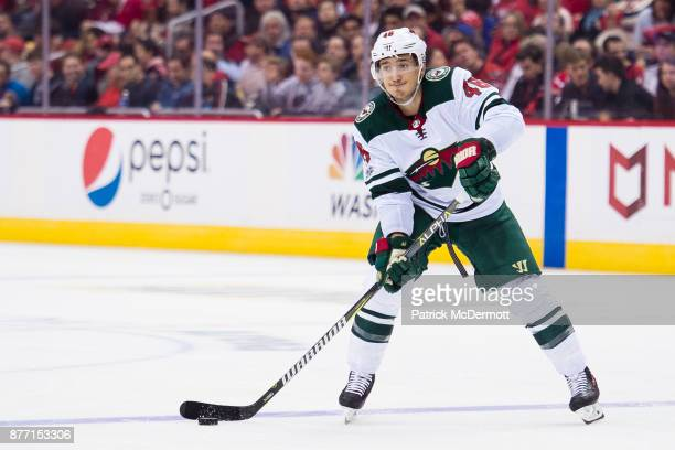 Jared Spurgeon of the Minnesota Wild skates with the puck in the second period against the Washington Capitals at Capital One Arena on November 18...