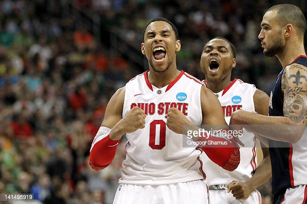 Jared Sullinger and Deshaun Thomas of the Ohio State Buckeyes reacts in the second half against Robert Sacre of the Gonzaga Bulldogs during the third...