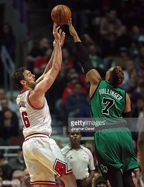 Jared Sullinger of the Boston Celtics blocks a shot by Pau Gasol of the Chicago Bulls at the United Center on January 7 2016 in Chicago Illinois The...