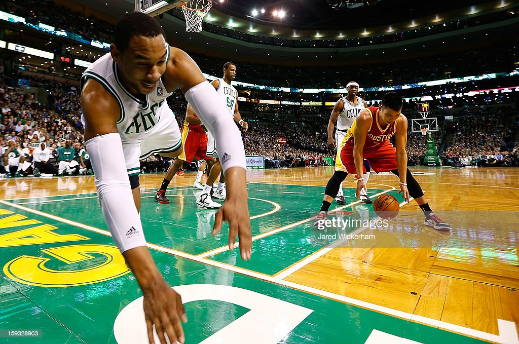 Jared Sullinger #7 of the Boston Celtics dives out of bounds after being fouled in front of Jeremy Lin #7 of the Houston Rockets during the game on January 11, 2013 at TD Garden in Boston, Massachusetts.