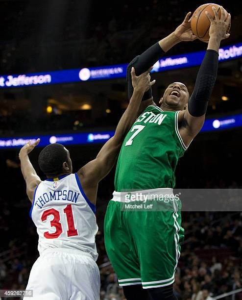 Jared Sullinger of the Boston Celtics goes up for a shot and is fouled by Hollis Thompson of the Philadelphia 76ers on November 19 2014 at the Wells...