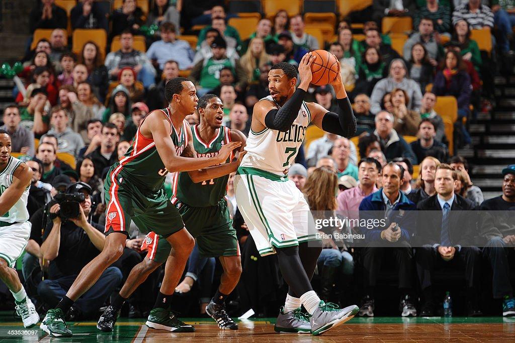 Jared Sullinger #7 of the Boston Celtics protects the ball against John Henson #31 of the Milwaukee Bucks on December 3, 2013 at the TD Garden in Boston, Massachusetts.