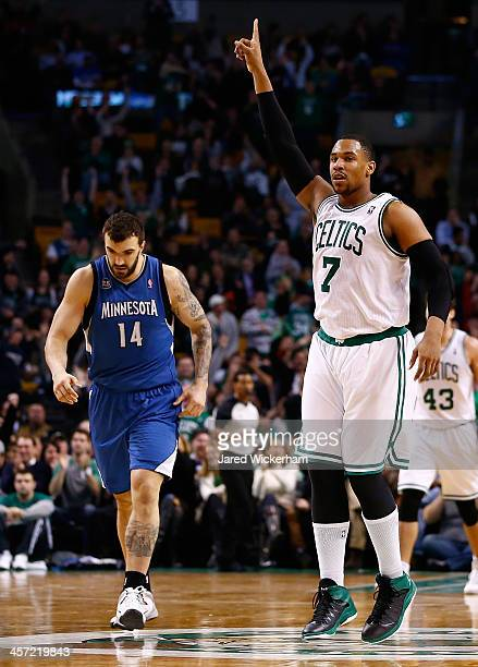Jared Sullinger of the Boston Celtics reacts following a made threepoint shot late in the fourth quarter against the Minnesota Timberwolves during...