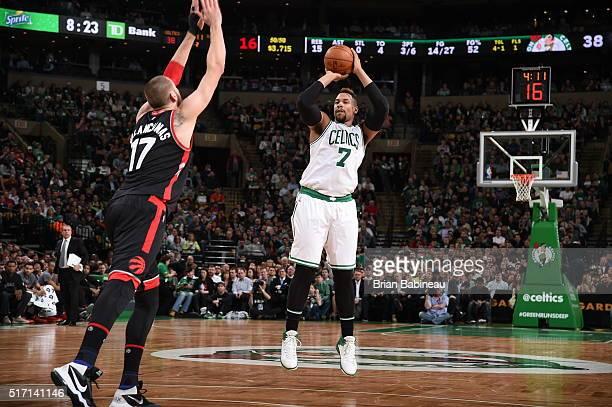 Jared Sullinger of the Boston Celtics shoots against Jonas Valanciunas of the Toronto Raptors on March 23 2016 at the TD Garden in Boston...
