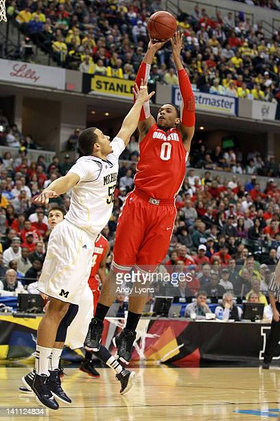 Jared Sullinger of the Ohio State Buckeyes attempts a shot against Jordan Morgan of the Michigan Wolverines during their Semifinal game of the 2012...