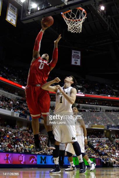 Jared Sullinger of the Ohio State Buckeyes attempts a shot against Stu Douglass of the Michigan Wolverines during their Semifinal game of the 2012...
