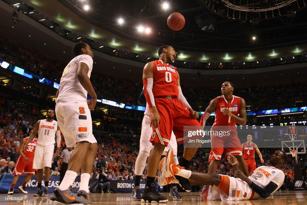 Jared Sullinger #0 of the Ohio State Buckeyes reacts after scoring over Baye Keita #12 of the Syracuse Orange during the 2012 NCAA Men's Basketball East Regional Final at TD Garden on March 24, 2012 in Boston, Massachusetts.