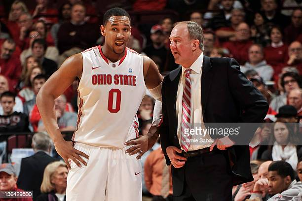 Jared Sullinger of the Ohio State Buckeyes talks with Head Coach Thad Matta of the Ohio State Buckeyes on January 3 2012 at Value City Arena in...