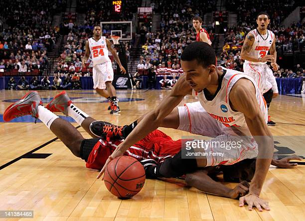 Jared Swopshire of the Louisville Cardinals dives for the ball and lands on De'Mon Brooks of the Davidson Wildcats in the second round of the 2012...