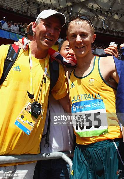 Jared Tallent of Australia celebrates his silver medal with coach Brent Vallance in the Men's 50km Walk at the National Stadium on Day 14 of the...