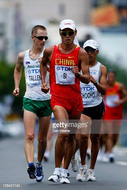 Jared Tallent of Australia Tianfeng Si of China and Andres Chocho of Ecuador compete in the men's 50km race walk during day eight of the 13th IAAF...