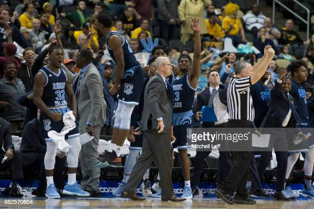 Jared Terrell Kuran Iverson Stanford Robinson and head coach Dan Hurley of the Rhode Island Rams react from the bench against the Virginia...