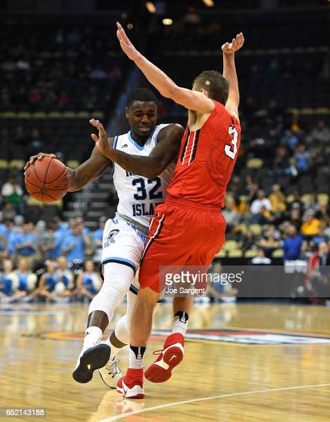 Jared Terrell of the Rhode Island Rams is fouled by Jon Axel Gudmundsson of the Davidson Wildcats during the semifinals of the Atlantic 10 Basketball...