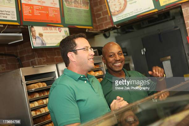 """Jared """"The Subway Guy"""" and Willie Randolph the Limited Edition Subway Bag Giveaway at Subway Restaurant on July 16, 2013 in New York City."""