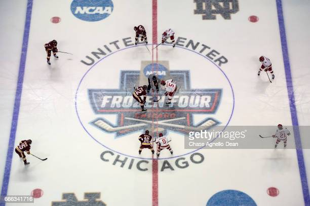 Jared Thomas of the MinnesotaDuluth Bulldogs and Henrik Borgstrom of the Denver Pioneers face off during the 2017 NCAA Div I Men's Ice Hockey...